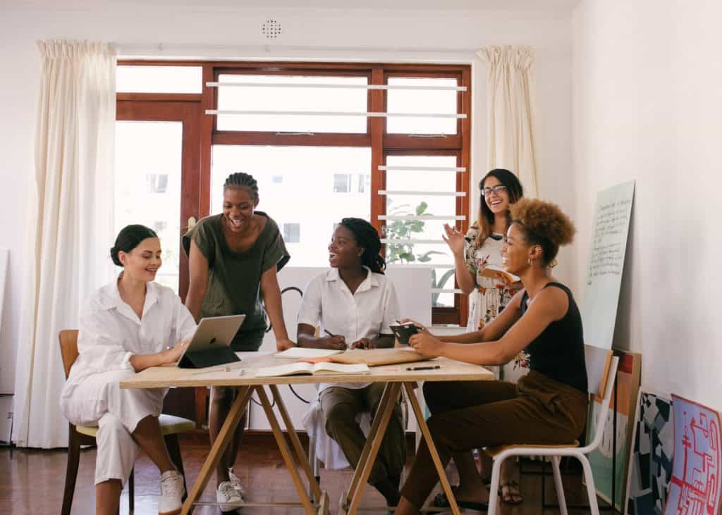 A group of culturally diverse women have a business meeting
